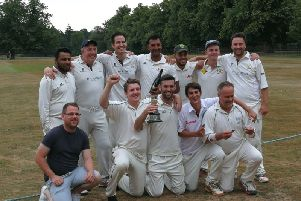 Potten End's Coronation Cup-winning side with the silverware.