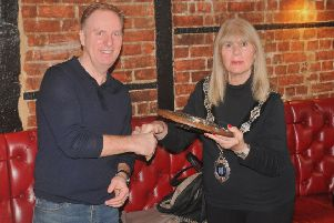 Chairman of Berkhamsted Cycling Club, Mike Plowman, is presented with the Harp Hilly 100 Shield by the mayor of Berkhamsted, Councillor Sue Beardshaw.
