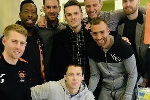 From left, Hemel skipper Jordan Parkes, Lloyd Doyley, Tom Hamblin, Kyle Connolly, Laurie Walker, Scotty Shulton and James Kaloczi meeting Spencer McCall in hospital recently.