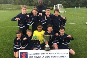 Berkhamsted Prep U11s were presented with their national championship medals by former West Ham star striker Marlon Harewood.