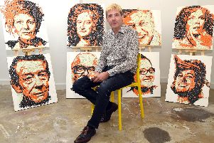 Artist Ed Chapman with some of his top 10 East Midlander portraits, including Jennifer Saunders - born in Sleaford.