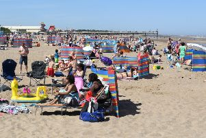 Crowds enjoy the hot weather at the beach. Photo for illustration only.