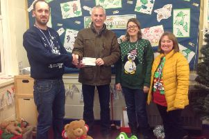 Headteacher Steve Bladon (left) pictured receiving a cheque from The Lions.