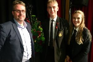 Tim Shipman is pictured with Head Boy Tom Massey and Head Girl Joanna Ward.