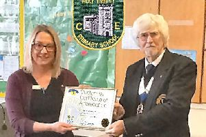 Lion President Wally presented Holy Trinity CE School in Tattershall's head teacher Mrs Liley with a Centennial Certificate of Appreciation. EMN-181230-082204001