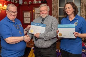 Lions President John Ginty with new member Richard Brown and sponsor Katie Liddy. Photo: John Aron.