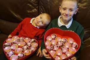 Eight-year-old Callum Drew (right), with his brother Luke.