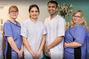 Smitha Susan Mathew and Manu Cherian with staff at the Horncastle practice. EMN-191103-154540001