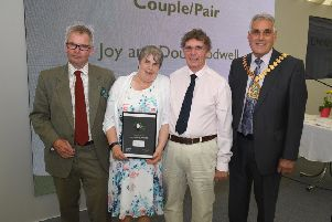 Lincolnshire County Council awards, presented by leader of LCC Martin Hill (left) and chairman of LCC Tony Bridges (right). Couple of the Year is Joy and Doug Rodwell, of Hemingby.
