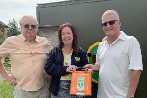 Pictured from left are Noel Bush, Kirsty Raywood and Pete Smith with the defibrillator. EMN-190624-131244001