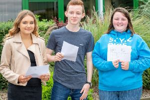 Three Banovallum School students collect their results.