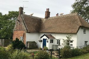 The kangaroo on the new thatched roof at the Old Grange