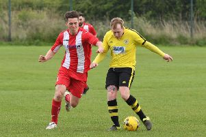 Horncastle's Andrew Bullivant and Wyberton's Daniel White in action at The Causeway last season.
