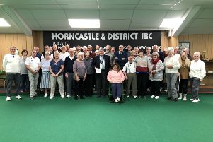 Pictured are Annalisa Dunham, Tom Scholey, Mary Johnson, group members from the Wong Day Centre and some of the Tuesday morning social bowlers.