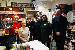 Pat and Ray Darby (left) with shop staff and Age UK Lindsey CEO Andy Storer. (far right)