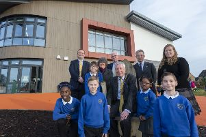 Jemima Adeoye, Director of Education and Children's Services Laurence Findlay, Elizabeth Lyall, Cooper Masson, Cllr Gillian Owen, Cllr Jim Gifford, Provost Bill Howatson, Chief Executive Jim Savege, Tami Fadeyi, Ruaridh Cumming and Head Teacher Pamela Farquhar with pupils outside the new Kinellar School