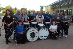 Members of Kintore Pipe Band are gearing up for the Bennachie charity walk