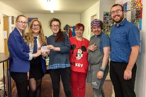 Emma Wilson and Katherine Atkins present the donation to members of Inspire Inverurie and Chris Simpson