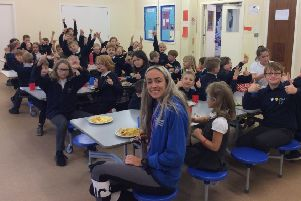 Eilish enjoys lunch with pupils from Oyne Primary School