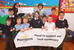 Morrisons Inverurie Community Champion Suzanne Hyde presents the money to the After School Club