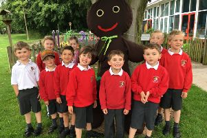 Thorns Infant pupils with the Gingerbread Man scarecrow