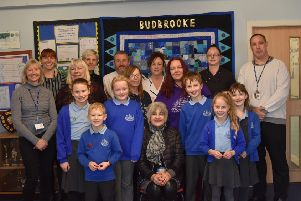 Members of the midday team, the catering team and some pupils with Pat Golding (seated).