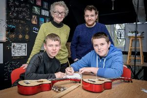 Viv Morgan founder of Northleigh school's with teacher Tom Pettitt and pupils Jordy and George.