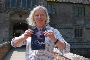 Anne Elliott with her new book