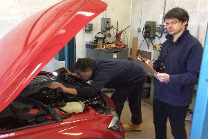 Warwickshire Trading Standards officers inspect a car.