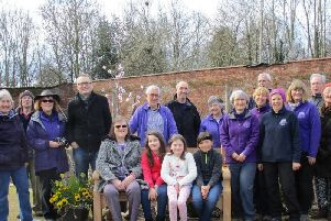 The installation of the bench at Guy's Cliffe Walled Garden. Photo submitted.