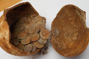 The hoard was uncovered during an archaeological dig at a Roman site on the Edge Hill in 2015. They were buried in a ceramic pot more than 1900 years ago, under the floor of a building. Photo by Warwickshire County Council.