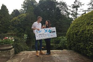 Sam Lawton and his partner Connie Bell celebrate their win in the National Lottery's Set for Life draw.