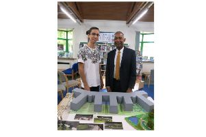 Former Kenilworth School student, architect Attila Csutoras and head teacher Hayden Abbott admire the 3D model Attila created of his vision of the new school site as art of his product design A level.