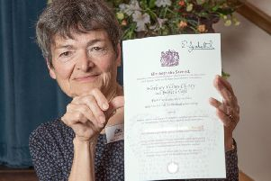 Sharon Hancock with the certificate.