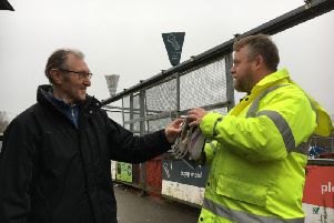A Warwickshire County Council employee collects an item from a member of the public
