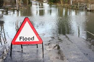A flood warning sign posted by Warwickshire County Council officials from Storm Dennis