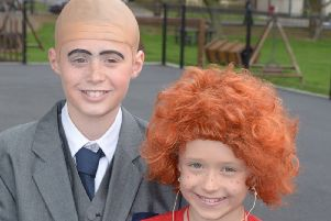 Annie (Koriann) and Mr Warbucks (Ben) In Linn Primary School's Annie. INLT 16-344-PR