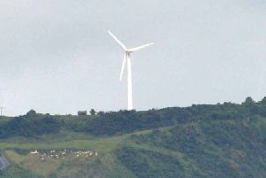 Wind turbine at Glenarm Head (file photo). INLT 27-006-PSB