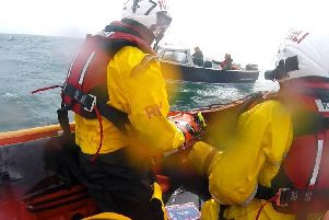 Lifeboat crew assist two people lost in fog