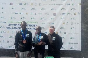 The top three male finishers in the 2018 Walled City Marathon, left to right, Eric Keoch (second), Dan Tanui (winner) and Thomas Maguire (third).