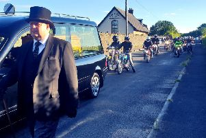 Bikers escort the late Trevor Black from Ian Milne Funeral Parlour on his final journey home