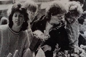 Hunting for bargains at the plant stand at the All Saints Church Summer Fete at Craigyhill. 1989. Click on the link below or image above to launch our gallery.