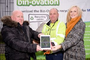 Mid & East Antrim Councill James McKeown takes a look at the Bin-ovation app with Senior HRC attendant David Ewing and Education Officer Catherine Hunter.