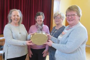 The winning Templepatrick team Roberta Stinson, Hilary Becket and Carol Borland received a trophy presented by area president Ann Graham.