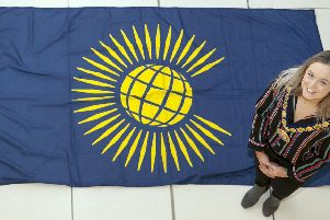 The Deputy Mayor of Mid and East Antrim, Cllr Cheryl Johnston, with the Commonwealth flag.