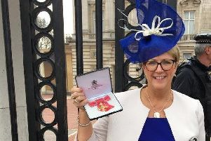 Marie Roulston, Director of Social Care and Children, Health and Social Care Board, pictured after receiving her OBE for services to healthcare and young people at an investiture ceremony held at Buckingham Palace.
