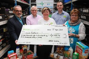 (From left) Andy Murray, Asda Chief Customer Officer, Alex Munroe, Secretary at Larne Foodbank, Catherine Mc Callion, Asda Larne Community Champion, Stuart Legge, Asda Larne Store Manager and Joan Irwin, Chairperson at Larne Foodbank