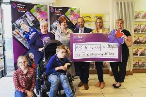 Back (from left) Catherine O'Hara, NI Children's Hospice , Cllr Noreen McClelland , Jim McMillan Estate Agents Director Barrie McClure, CEO Mallusk Enterprise Park, Emma Garett, D�cor Centre Director Joanne Mahood. Front: Madison Wright and Sam McBride.