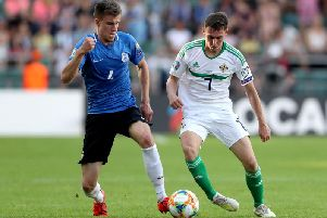 Estonia's Mattias Kait with Northern Ireland's Gavin Whyte