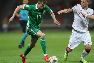 Belarus' Denis Polyakov with Northern Ireland's Paddy McNair